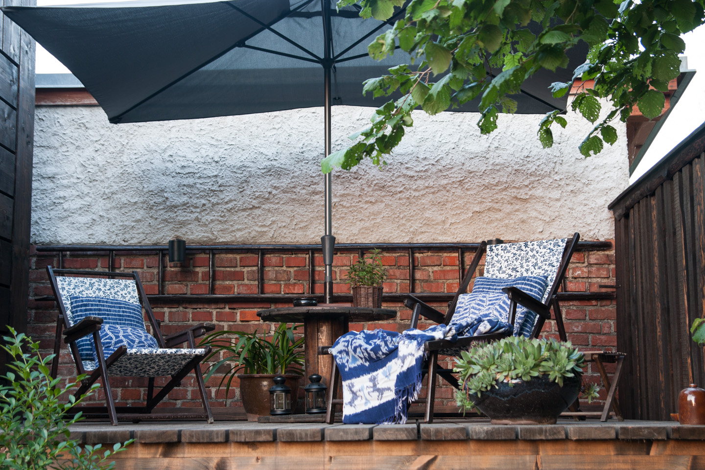 Private terrace with lounge chairs and garden view