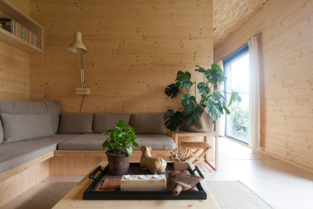 Living room with reading corner and sofa