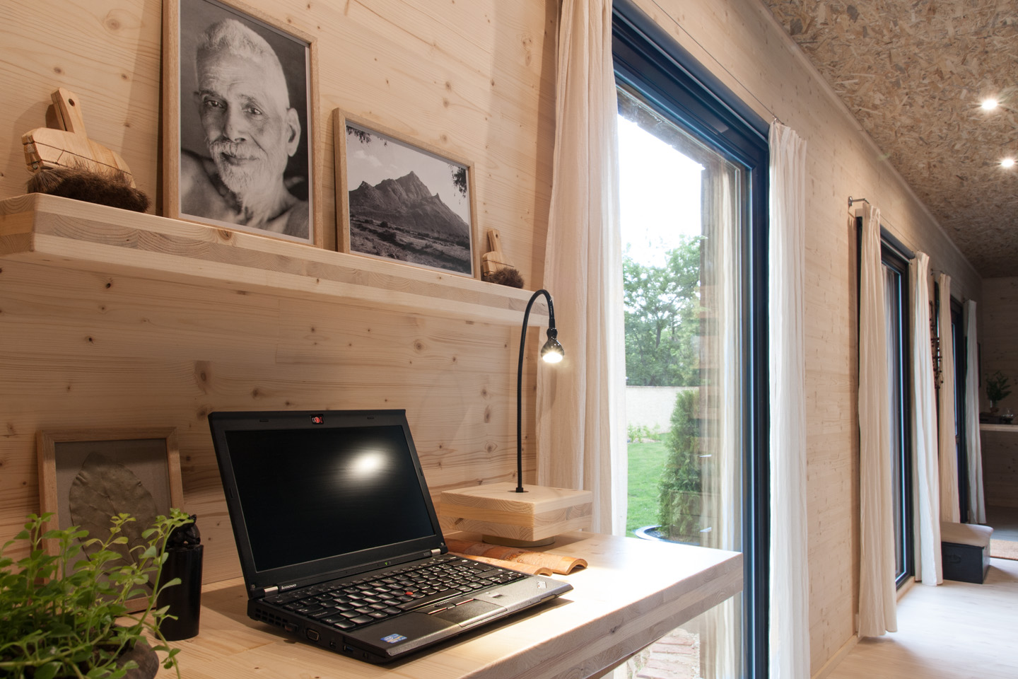 Office corner with desk and seat for quick laptop work